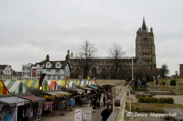 Fine medieval great church overlooking colourful market stalls